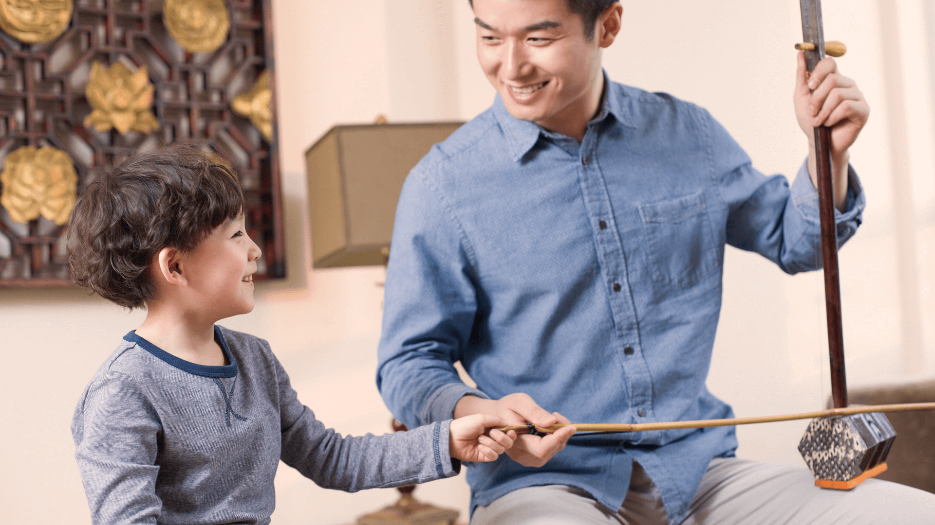Erhu teacher helping with erhu lessons at Ping's Music School