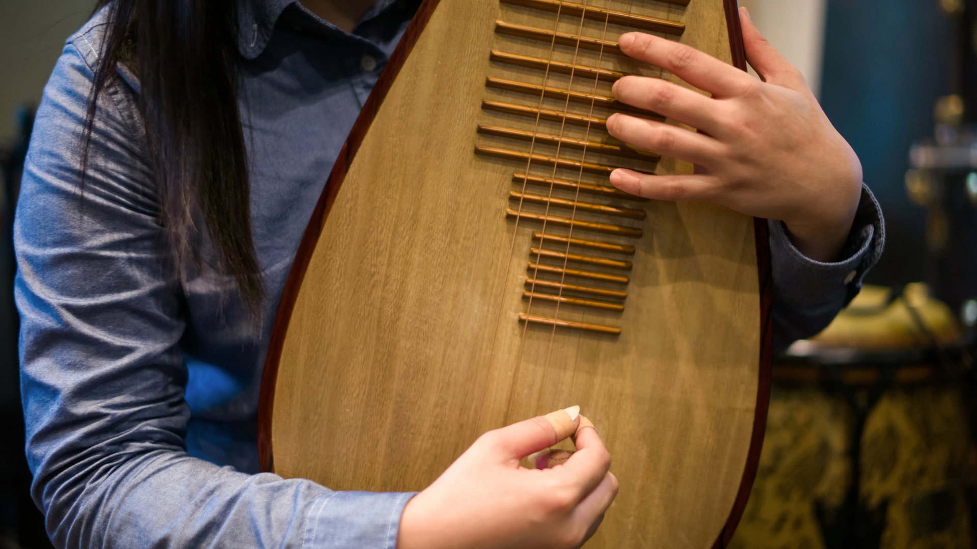 Close up of a student learning the pipa