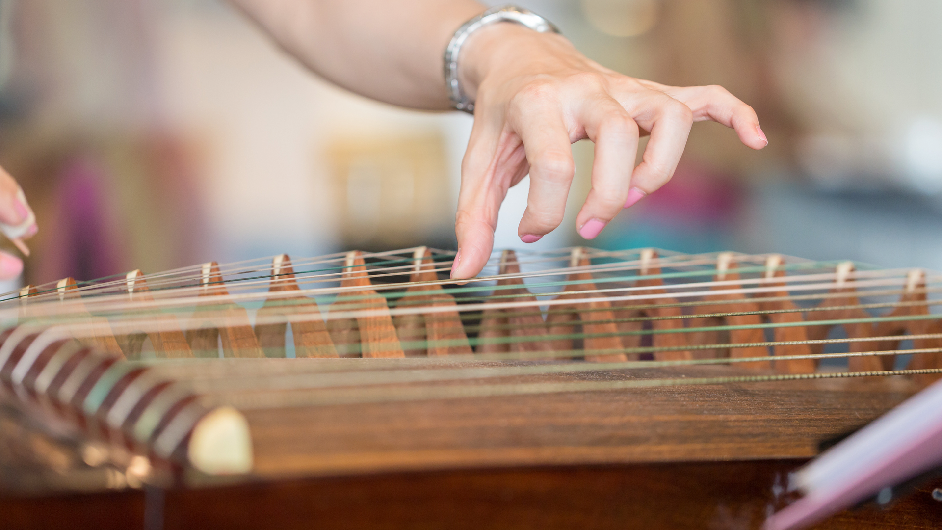 A woman taking guzheng lessons