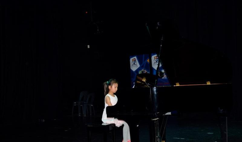 Young student performing piano