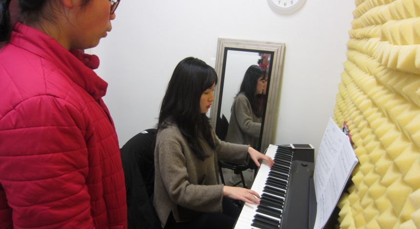 Piano teacher teaching a student