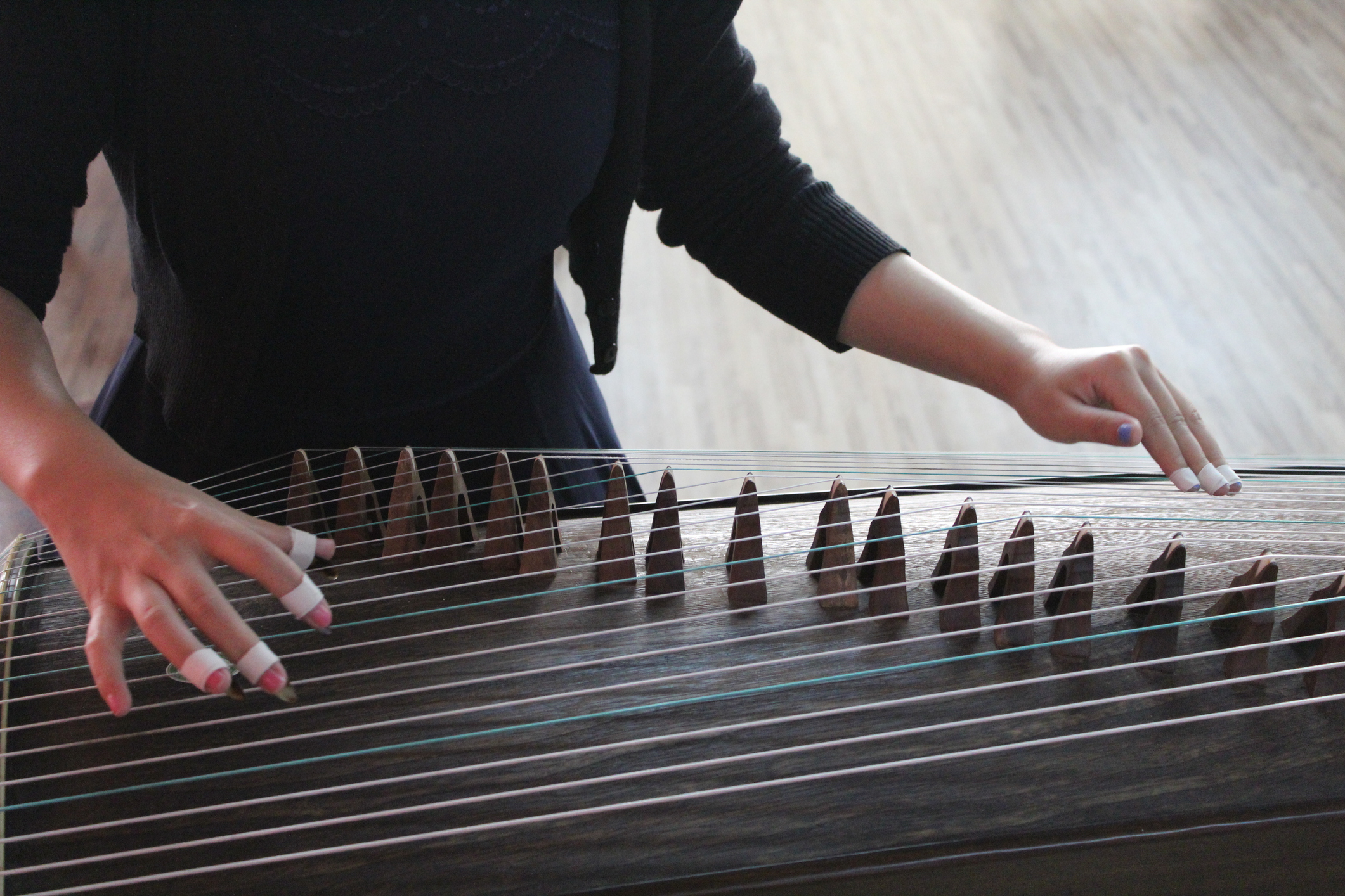 Woman Playing Guzheng